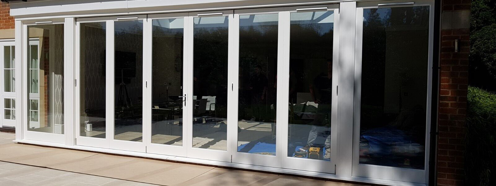 Wooden bifold door header
