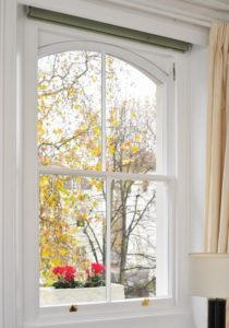 Arched wooden sash window